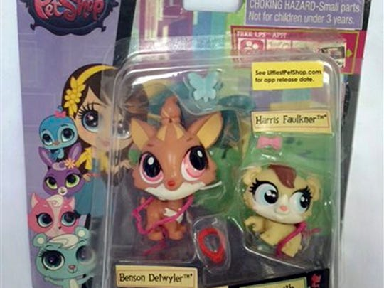 """This June 23, 2015 photo released by the Hogan Lovells law firm shows toys from Hasbro's """"Littlest Pet Shop"""" line in New York, including characters named Benson Detwyler and Harris Faulkner. Fox News anchor Harris Faulkner sued Hasbro Monday, Aug. 31, 2015, in federal court in New Jersey for more than $5 million over the toy that shares her name. Harris' suit claims Hasbro wrongfully appropriated her name and persona with its plastic """"Harris Faulkner"""" hamster."""