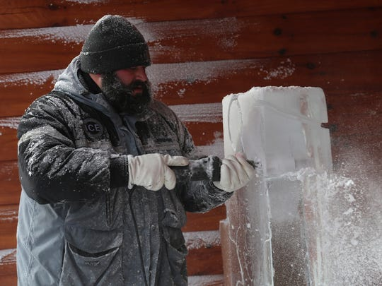 Jeff Meyers of Broadview Heights craves an ice sculpture  during Mohican Winter Fest in downtown Loudonville on Saturday.