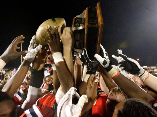 Oakland players hold up the Battle of the Boro Trophy after defeating Riverdale 43-14, on Friday, Sept. 15, 2017, at Oakland.