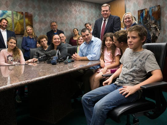 Hannah Overton is surrounded by family, friends and attorneys during a press conference at attorney David Jones law offices in Corpus Christi. Caller-Times File photo