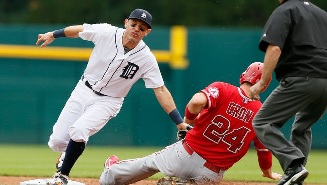 Detroit Tigers' Ian Kinsler puts the tag on Los Angeles Angels' C.J. Cron, trying to steal second base, for the third out of the second inning on August 27, 2015, in Detroit.