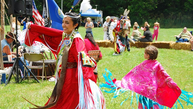 Americans should learn more about indigenous cultures rather than celebrate Christopher Columbus, a UC professor says. Shown, Bear Starfire McQuinn of Florence dances with Izabella Haemmerle, 4, during the Native American Inter-Tribal Weekend at Big Bone Lick State Historic Site in Union, Kentucky, in July.