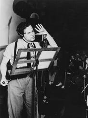 """Orson Welles takes to the mic as astronomer Professor Pierson for the Mercury Theatre on the Air's"""" production of """"The War of the Worlds"""" on Oct. 30, 1938."""