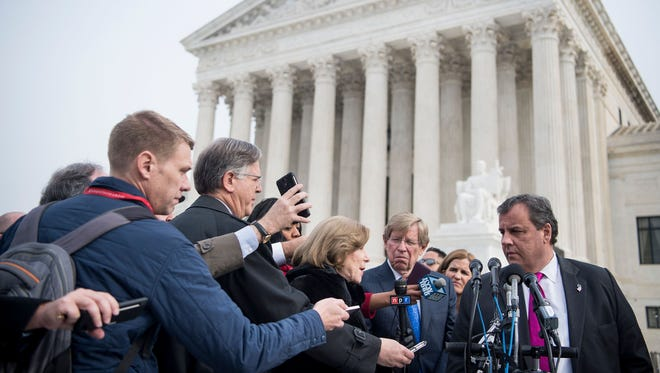 New Jersey Gov. Chris Christie speaks to reporters following the Supreme Court's oral argument on sports betting Monday.