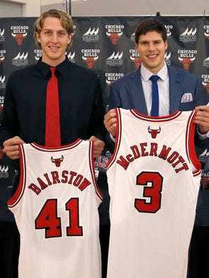 The Chicago Bulls' first and second round draft picks Cameron Bairstow (41) from Brisbane, Australia, and Creighton University star Doug McDermott,  pose with their Bulls jerseys during a news conference Monday, June 30, 2014, in Deerfield, Ill.