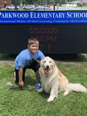 William Dedmond, 11, and his service dog, Soya, graduated this month after completing kindergarten through fifth grade together at Parkwood Elementary in Jacksonville.