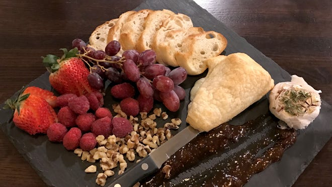 The Baked Brie appetizer at Magleby's in St. George is served with sourdough crostini, roasted garlic, a fig spread, nuts and fresh fruit.