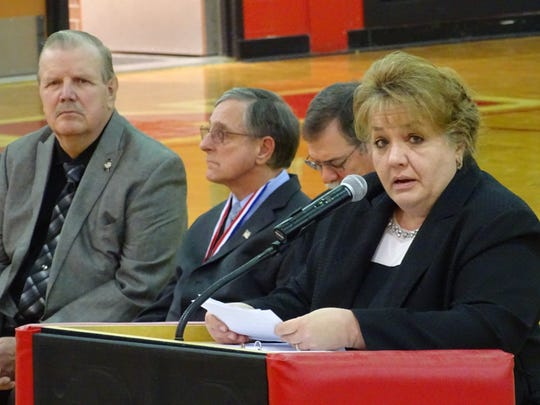 Jenny Vermillion, a Crawford County commissioner, thanks veterans Friday during the Veterans Hall of Fame induction ceremony at Bucyrus High School.