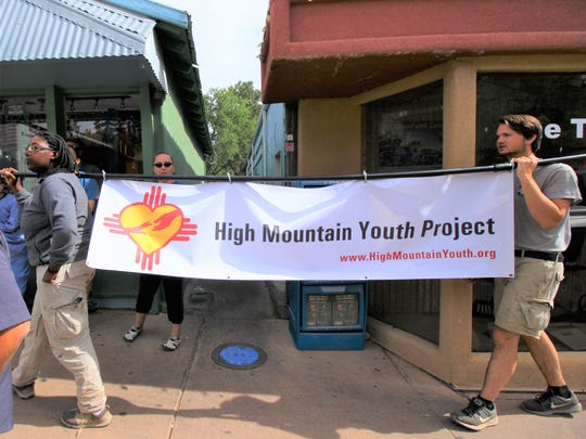 High Mountain Youth Project sign identified the beneficiary of race proceeds.