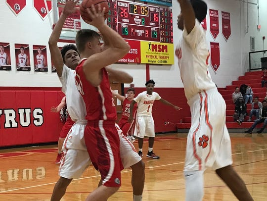 The Tygers double team a Port Clinton ballhandler.