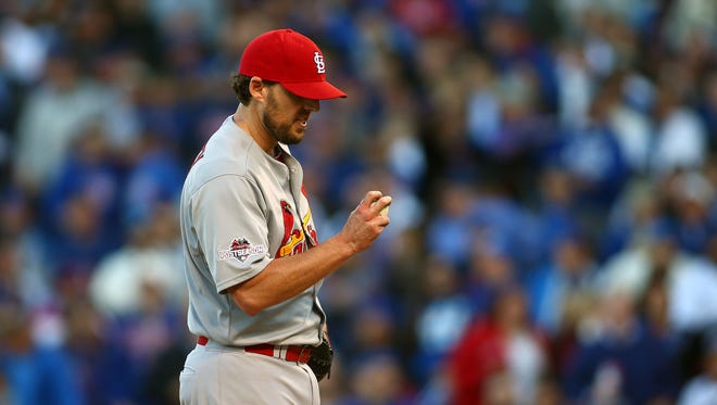 October 13, 2015: St. Louis Cardinals starting pitcher John Lackey (41) looks down as he is requested to exchange baseballs during his pitch in the third inning against Chicago Cubs in game four of the NLDS at Wrigley Field.