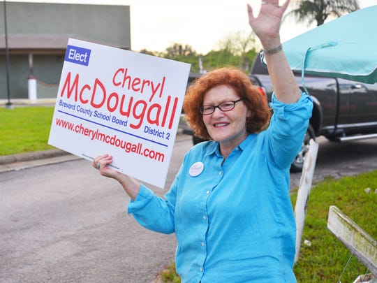 School board candidate Cheryl McDougall at the Moose Lodge. Candidates and supporters were out early Tuesday waving signs  and waving to voters at polling sites around the county.