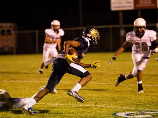 Christopher Taylor, 10, runs the ball during a play
