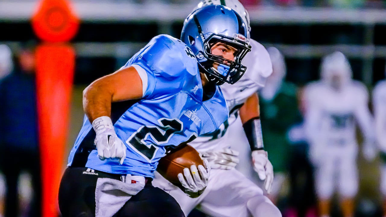 Tony Poljan of Lansing Catholic celebrates after forcing and recovering a Gabriel Richard fumble in the 2nd quarter of their game Friday October 16, 2015 in Holt.  Poljan rushed for three scores and threw for another in the 41-6 win.