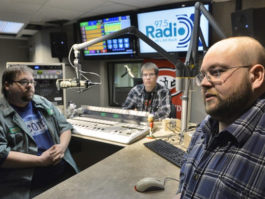 Jim Gray, right, adviser for the radio station 97.5 RadioX, talks in January 2015 about the 1990s alternative rock station. The station is run by Music Director Jesse Wheeler, left, and Program Director Trevor Klopp.