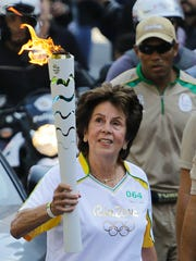 Maria Bueno takes part in the Olympic torch relay in