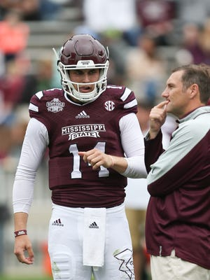 Dan Mullen talks to quarterback Nick Tiano during Mississippi State's spring practice.