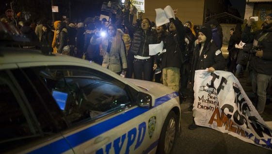 Demonstrators chant outside the 75th Police Precinct in New York.