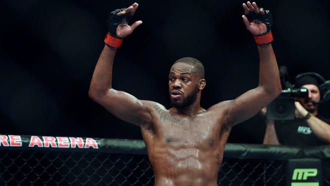Jon Jones celebrates after his UFC light heavyweight title victory against Glover Texeira Saturday night