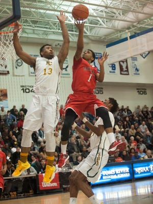 Paulsboro's Brandon Hamilton drives for a layup against Roselle Catholic's Matt Bullock (13) and Chris Silva during the in the NJSIAA Semifinal game in the Tournament of Champions at Toms River North High School. Hamilton finished with 8 points.