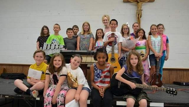 Photo is of music students with music teacher, Amy Ryfinski