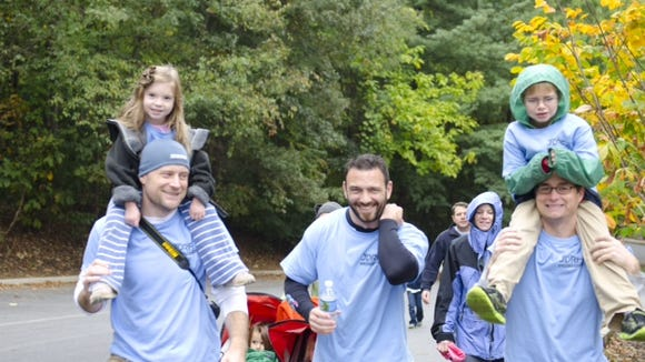 Families take part in a past walk in Asheville to raise money for the Juvenile Diabetes Research Foundation.