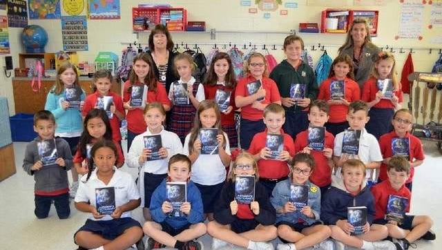 Photo is of Rotary Club representative Mrs Khoudary, 3rd grade teacher Mrs Emmons and students from Saint Aloysius 3rd grade.