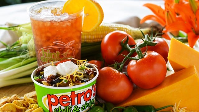 A Petro's chili and chips with Hint-of-Orange Iced Tea.