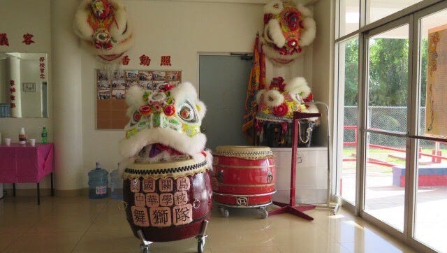 The drums and costume used in the Guam Chinese School lion dance .