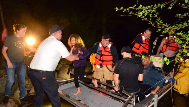 Emmett Township Public Safety Officers rescued four people who fell into the Kalamazoo River on Saturday.