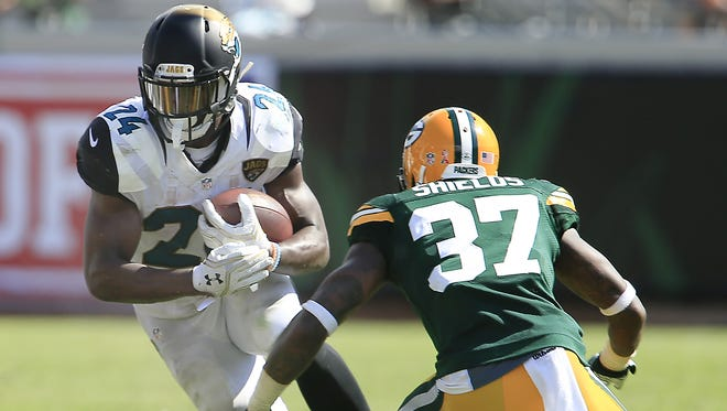Reinhold Matay-USA TODAY Sports Packers cornerback Sam Shields (37) goes after Jacksonville Jaguars running back T.J. Yeldon (24). Sep 11, 2016; Jacksonville, FL, USA;  Green Bay Packers cornerback Sam Shields (37) goes after Jacksonville Jaguars running back T.J. Yeldon (24) during the second  half of a football game at EverBank Field.The Green Bay Packers won 27-23. Mandatory Credit: Reinhold Matay-USA TODAY Sports