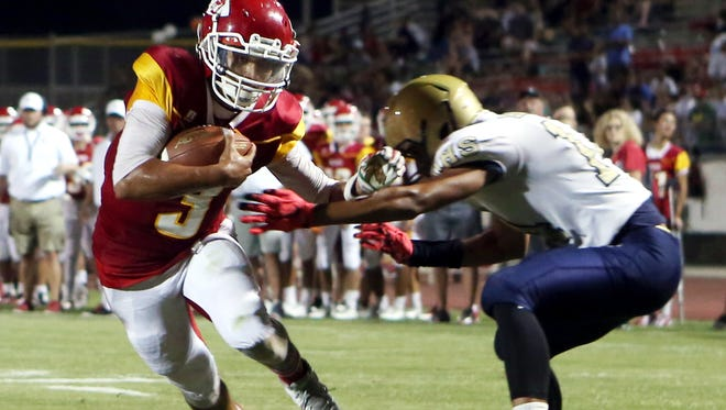 Palm Desert's Matthew Fitzgerald runs the ball for a second quarter touchdown against Desert Hot Springs High School in Palm Desert on Friday, August 26, 2016.