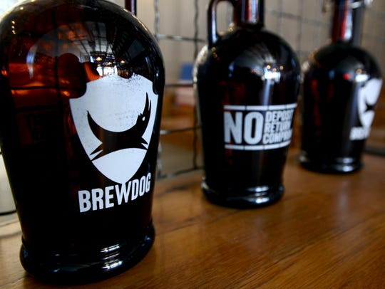 Empty growlers with BrewDog logos sit in the gift shop