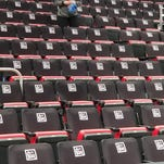 Pistons cover empty seats with black seat covers