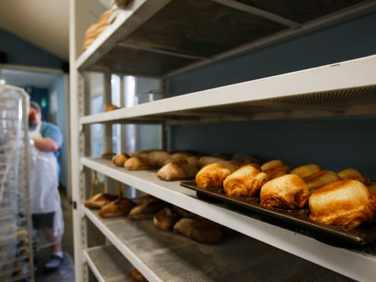 Freshly made Koiugn-amann, a French (Breton), a round crusty cake made with wheat, flour, water, and butter, salt, sugar, and yeasts.  It is described as a sweet, flaky, crosissant-like pastry.  [Matthew Dae Smith/Lansing State Journal]