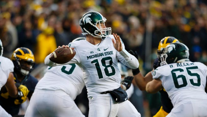 Michigan State quarterback Connor Cook looks to throw against Michigan earlier this season.