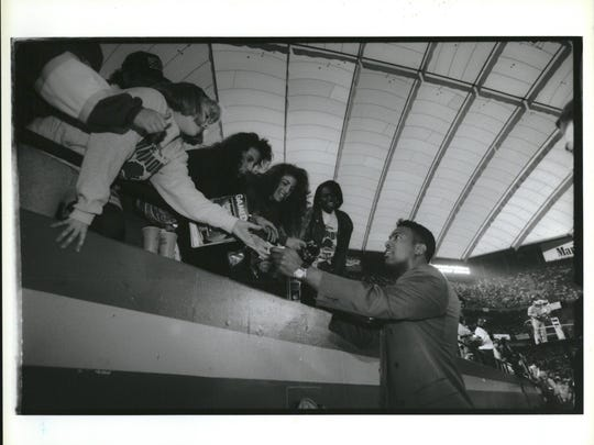 QB Rodney Peete greets fans before the playoff game at the Silverdome. Peete was injured during the season.