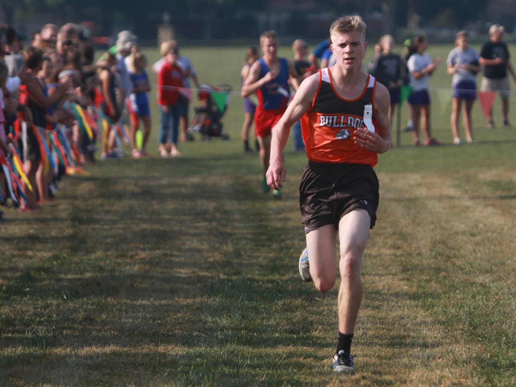 Taylor Hopkins of Heath finished 7th at the Newark Catholic Invitational with a time of 17:06 Saturday, leading the Bulldogs to the championship at Bryn Du Mansion.