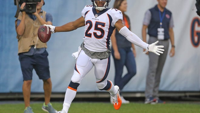 Aug 10, 2017; Chicago, IL, USA; Denver Broncos cornerback Chris Harris (25) celebrates after scoring a touchdown on an interception return during the first quarter against the Chicago Bears at Soldier Field. Mandatory Credit: Dennis Wierzbicki-USA TODAY Sports