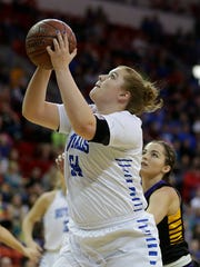 Assumption's Olivia Skibba (54) lays up a shot against
