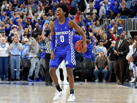 De'Aaron Fox celebrates at the end of a game against