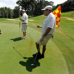 Golfers from left, Johnny Dollar, from left, Cutis Estes, Bill Morgan and Kip Dollar play at the Robert Trent Jones Golf Trail Capitol Hill in Prattville, Ala., on Wednesday July 1, 2015.