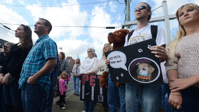 Protesters gather at Commonwealth Attorney Gary Agar's office in an effort to convince him to pursue charges against two PETA workers who allegedly took Maya, a family's chihuahua, and admitted to having the pet euthanized.