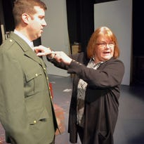 Cyndie Verbeten, director of The Center for the Arts' December production of White Christmas, reviews costumes with Jamie Sommers Lawler, who plays Betty Haines, half of the singing duo, the Haines Sisters.