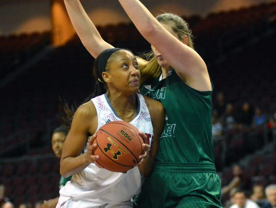 New Mexico State's Brianna Freeman goes in for a shot