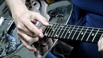 Despite Parkinson's, 'Dr. Robert' keeps the music playing