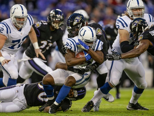 Indianapolis Colts running back Frank Gore (23) is wrapped up by the Baltimore Ravens defense after a short run in the first quarter at M&T Bank Stadium in Baltimore on Saturday, Dec. 23, 2017.