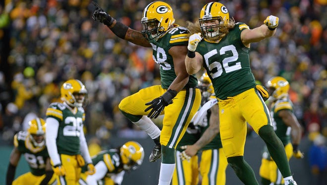 Green Bay Packers linebackers Sam Barrington (58) and Clay Matthews (52) celebrate a fourth quarter defensive stand. The Green Bay Packers defeated the New England Patriots 26-21 at Lambeau Field in Green Bay, Wis. on Sunday, Nov. 30, 2014.