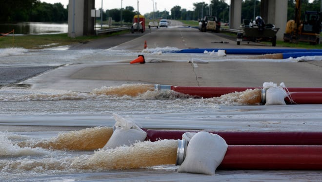 Lines were being used to pump  water from Red River away from sewer lines in Bossier City in June, 2015.