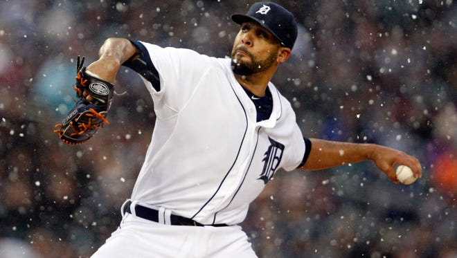 Detroit Tigers starting pitcher David Price pitches in the snow during the first inning against the New York Yankees at Comerica Park.